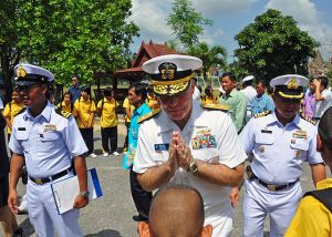 U.S. Navy Rear Adm. Thomas Carney returns a boy's traditional Thai greeting