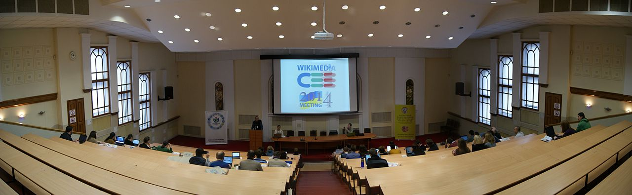 "The main hall at the Wikimedia Central and Eastern European Meeting 2014 in Kyiv, Ukraine.""Main Hall Panorama"" by Taras r, under CC-BY-SA-4.0"