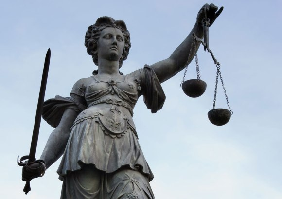 Photo of Lady Justice by Roland Meinecke, licensed under Free Art license.