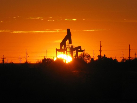 The sun sets behind a pump jack in Texas. The National Institute for Occupational Safety and Health (NIOSH) is involved in researching safety for oil rig workers, who carry out risky jobs in dangerous environments. Photo by NIOSH, public domain